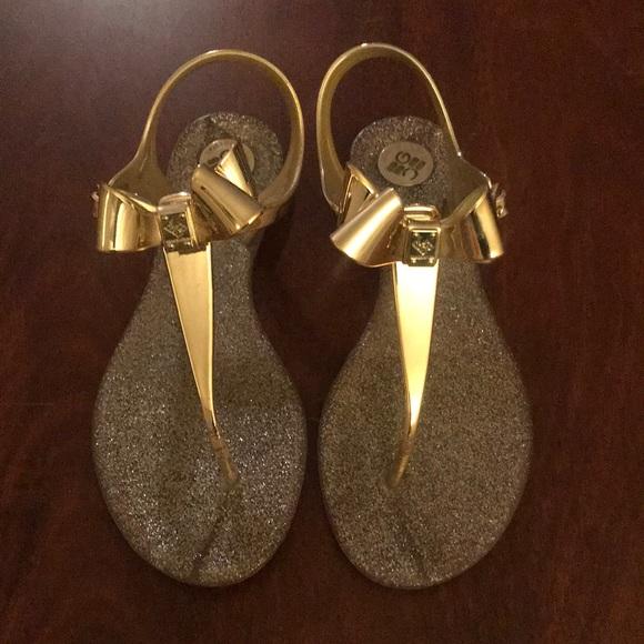 d3798aaee478 BCBGeneration Shoes - BCBG gold bow sandals